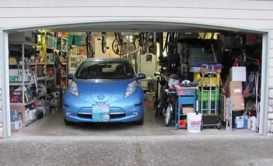 One car and lots of stuff in a two-car garage.
