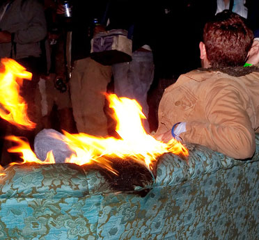 Man sitting on burning couch