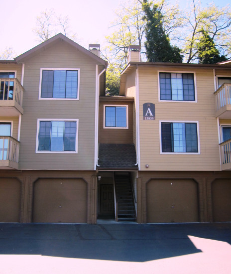 Ground level garages dominate the street entrance to these townhomes.