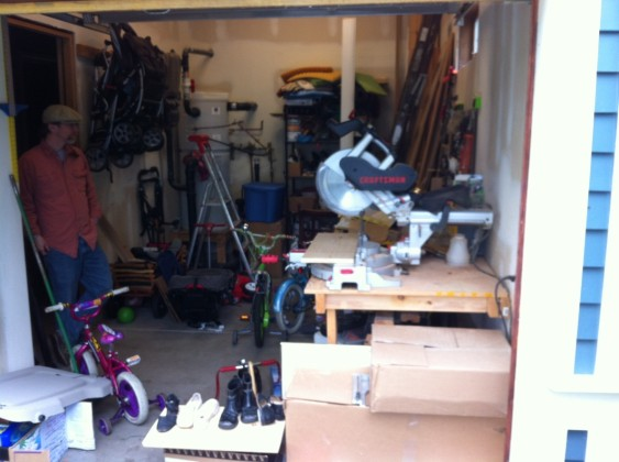Woodshop and kids bikes in garage.